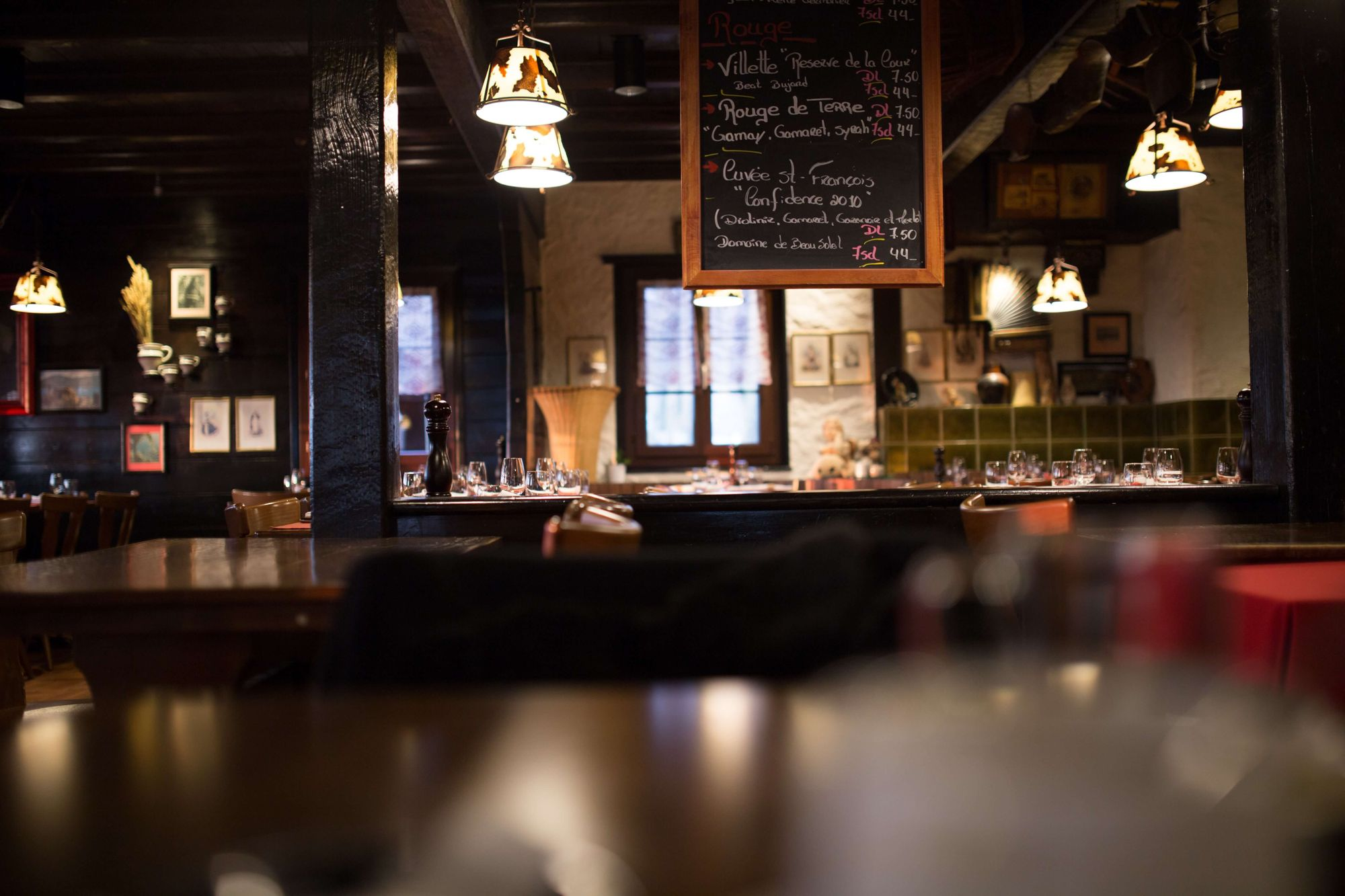 pub with empty tables and chalkboard menu